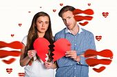 Couple holding broken heart against hearts