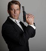 Handsome Man In Tuxedo With Gun