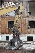 Close up of a Excavator demolish a House