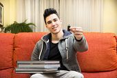 Young man showing difference between USB drive and heavy books