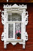 Window With  Flowers On A  Sill