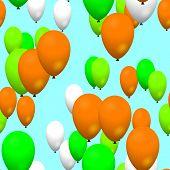 Green orange white air party balloons on sky