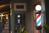 A Glowing Barber Pole On A Shop Porch