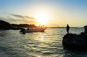 Man Fishing In The Caribbean Sea At Sunrise