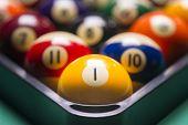Billiard Balls Arranged In A Triangle; Macro;focus On The Yellow Ball