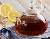 Glass Teapot With  Tea And Fresh Lemon