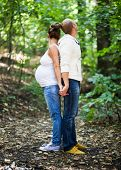 Husband And Pregnant Wife Back To Back