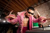 stock photo of lps  - Cool Asian DJ at a 1970s Disco Music Party - JPG