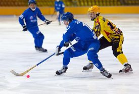 image of dynamo  - MOSCOW - DECEMBER 12 2014: Poputnikov D. (10) attacks during the Russian bandy league game Dynamo Moscow vs SKA Neftyanik in sport palace Krilatskoe Moscow Russia. Dynamo won 9:1
