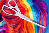 picture of wig  - scissors with color wig on a blue background - JPG