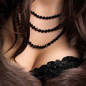 foto of corset  - woman wearing corset and fur in retro style - JPG