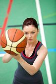 Portrait Of A Concentrated Young Woman Playing Basket-ball
