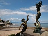 picture of malecon  - Mermaid statues on the Malecon walkway in Puerto Vallarta Mexico - JPG