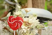 image of valentine candy  - Candy valentines hearts on background of flowers - JPG