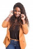 stock photo of telephone operator  - A friendly african telephone operator smiling isolated over a white background - JPG