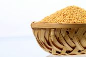 picture of mustard seeds  - yellow mustard seeds in wooden  - JPG