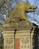 Wild Boars Head At Entrance Of Charlecote Park Warwickshire England poster