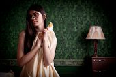 picture of sexuality  - Sexy naked girl with bed sheets in hands on green vintage wall - JPG