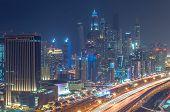 image of dubai  - A skyline panoramic view of Dubai Marina showing the Marina and Jumeirah Beach Residence - JPG
