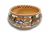 picture of ceramic bowl  - Ceramic bowl with floral ornaments on a light background - JPG