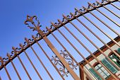 picture of wrought iron  - Stylish wrought iron gate in a park - JPG