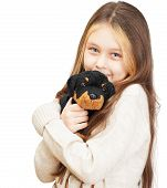 picture of toy dogs  - little girl with long hair holding a toy dog - JPG