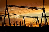 picture of power transmission lines  - Silhuettes of power lines station against clouds - JPG