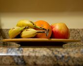 foto of fruit platter  - Mixed fruit sitting on a plate on a granite countertop - JPG