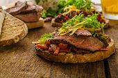 foto of cheese-steak  - Devilish fried bread with peppers chilli and beef steak topped cheddar cheese and microgreens with czech beer - JPG