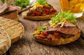 image of cheese-steak  - Devilish fried bread with peppers chilli and beef steak topped cheddar cheese and microgreens with czech beer - JPG