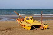 stock photo of lifeguard  - Single lifeguard boat on the seashore of a beach - JPG