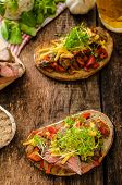 stock photo of cheese-steak  - Devilish fried bread with peppers chilli and beef steak topped cheddar cheese and microgreens with czech beer - JPG