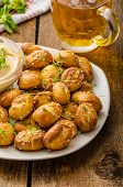 stock photo of pretzels  - Pretzel rolls homemade cheese dip from cheddar with beer and mustard - JPG