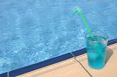 image of corazon  - gorgeous blue corazon cocktail at the pool side - JPG
