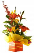 stock photo of flower arrangement  - bright boquet of flowers arranged in gift box - JPG
