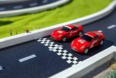 Two Red Toys Racing Cars poster