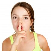 Primary Aged Girl Making Shush Gesture