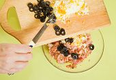 Adds Grated Eggs And  Sliced Olives In Mincemeat