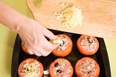 Cook Adds Cheese To Stuffed Tomato