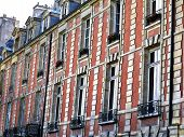 Paris And The Beautiful Buildings Of The Places Des Vosges Neighborhood