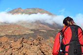 Woman Hiking Looking At Mountain