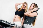 Two Female Djs At The Turntables