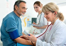 image of medical assistant  - Patient is being observed by doctor  - JPG