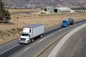 pic of 18 wheeler  - Long haul eighteen wheelers depend upon a well maintained infrastructure and interstate highway system - JPG