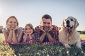 Happy Family With Dog poster
