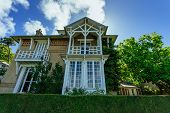 Country House With Green Fence In The Region Of Normandy, France On A Sunny Day. Beautiful Countrysi poster