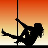 stock photo of pole dancer  - silhouette of a pole dancer - JPG