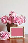 A bunch of blush pink roses in an antique brass bucket. Gold and white rustic frame. Shabby chic aga poster