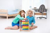 Kids Playing With Wooden Abacus. Educational Toy. poster