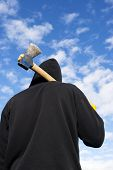 pic of infraction law  - man with an axe on sky background - JPG